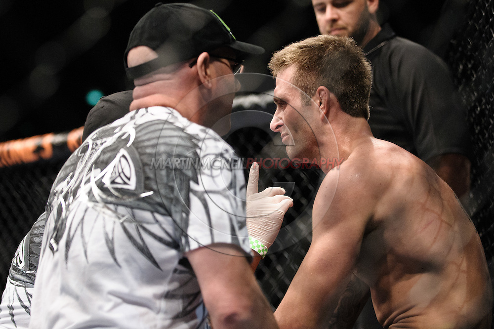"""SYDNEY, AUSTRALIA, FEBRUARY 27, 2011: Curt Warburton (right) sits on a stool between rounds during """"UFC 127: Penn vs. Fitch"""" inside Acer Arena in Sydney, Australia on February 27, 2011."""
