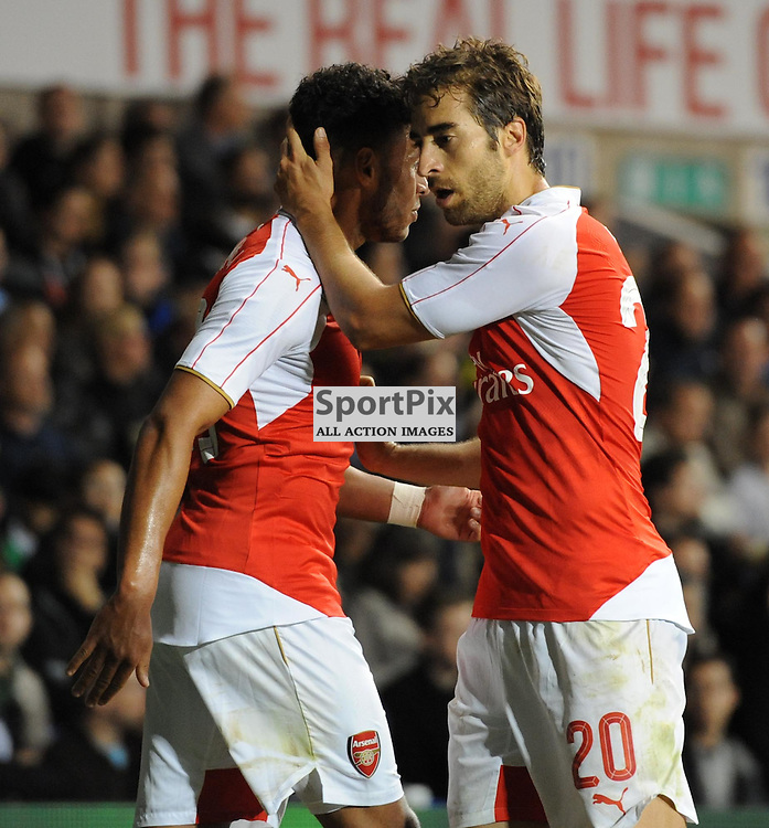 Arsenals Matthieu Flamini celebrates with Alex Oxlade Chamberlain after restoring Arsenals lead during the Capital One Cup third round tie between Tottenham and Arsenal on 23rd September 2015