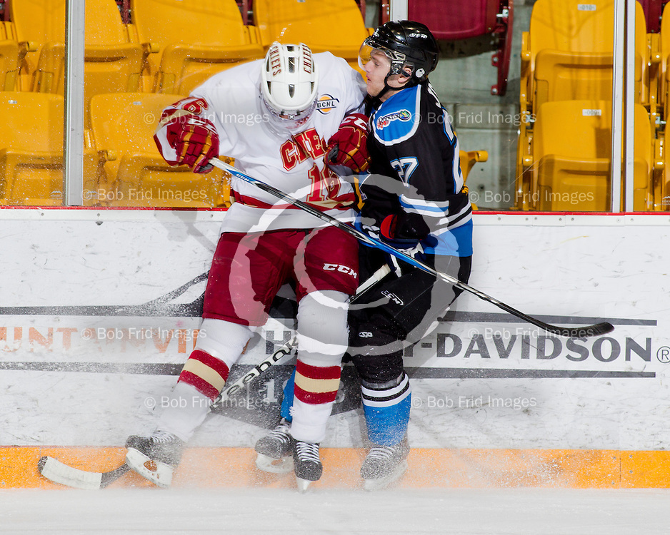 20 March 2012:  Kody Dhaliwal (16) of the Chiefs, DJ Jones (27) of the Vees  during a playoff game between the Chilliwack Chiefs and the Penticton Vees. Game #4 of best of 7. Final Score: Chilliwack 3 Penticton 1 - the  Best of 7 series is now tied at 2-2.  Prospera Centre, Chilliwack, BC.  ****(Photo by Bob Frid/Freemotionphotography.ca) All Rights Reserved : cell 778-834-2455 : email: bob.frid@shaw.ca ****