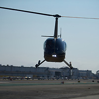 A Robinson R44 Helicopter comes back in for a landing at Hawthorne Airport in Los Angeles