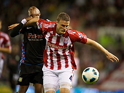 STOKE, ENGLAND - Monday, September 13, 2010: Aston Villa's Ashley Young and Stoke City's Robert Huth during the Premiership match at the Britannia Stadium. (Photo by David Rawcliffe/Propaganda)
