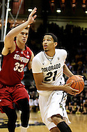 January 24th, 2013 Boulder, CO - Colorado Buffaloes junior forward André Roberson (21) drives to the hoop past Stanford Cardinal junior forward Dwight Powell (33) during the NCAA basketball game between the Stanford Cardinal and the University of Colorado Buffaloes at the Coors Events Center in Boulder CO