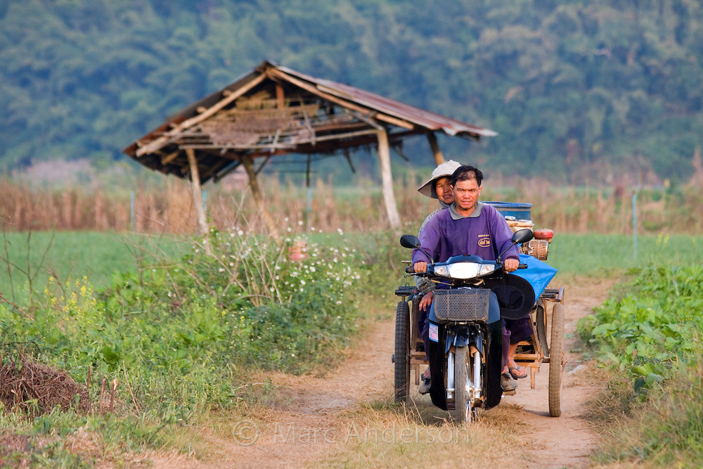 Man and woman on a bike in the countryside, Tha Ton, Chiang Mai Province, Thailand