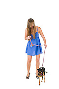 woman in blue dress walks her dog On white Background