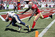 San Diego Chargers running back Ryan Mathews (24) is chased by San Francisco 49ers inside linebacker Patrick Willis (52) as he dives and scores a first quarter touchdown after a 25 yard pass reception and run, though the score was called back due to a penalty, during the 2014 NFL preseason football game against the San Franisco 49ers on Sunday, Aug. 24, 2014 in Santa Clara, Calif. The 49ers won the game 21-7. ©Paul Anthony Spinelli