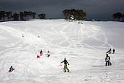 Locals enjoy snowboarding and sledding at the Eastward Ho Country Club and Golf Course in Chatham, MA after winter storm Juno dumped massive amounts of snow on Cape Cod.