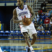 Delaware 87ers Forward Malcolm Lee (14) dribbles the ball up court in the first half of a NBA D-league regular season basketball game between the Delaware 87ers and the Rio Grande Valley Vipers (Houston Rockets) Saturday, Dec. 27, 2014 at The Bob Carpenter Sports Convocation Center in Newark, DEL