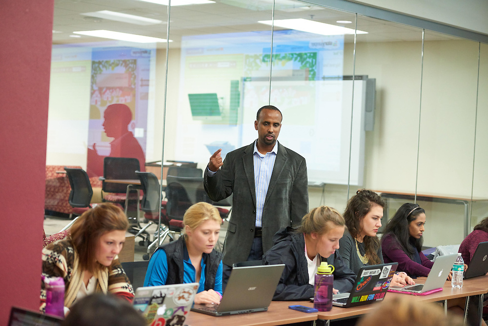 Activity; Teaching; Buildings; Murphy Library; Location; Inside; Classroom; Objects; Projector; People; Student Students; Professor; Man Men; Woman Women; Spring; April; Time/Weather; day; Type of Photography; Candid; UWL UW-L UW-La Crosse University of Wisconsin-La Crosse Ahmed Ali