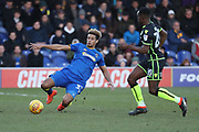 AFC Wimbledon striker Lyle Taylor (33) performing a sliding tackle during the EFL Sky Bet League 1 match between AFC Wimbledon and Bristol Rovers at the Cherry Red Records Stadium, Kingston, England on 17 February 2018. Picture by Matthew Redman.