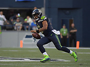 Aug 25, 2017; Seattle, WA, USA; Seattle Seahawks quarterback Russell Wilson (3) carries the ball against the Kansas City Chiefs during a NFL football game at CenturyLink Field. The Seahawks defeated the Chiefs 26-13.