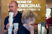 01 AUGUST 2012 - CHANDLER, AZ: People in Chick-fil-A in Chandler, AZ, Wednesday. Thousands of people stood in line for up to an hour at the Chick-fil-A in Chandler, AZ, a suburb of Phoenix Wednesday after MIKE HUCKABEE, the former governor of Arkansas and Fox News host, called for a national ''Chick-fil-A Appreciation Day,'' a day on which he encouraged people to patronize the fast food chain, this after DAN CATHY, President and CEO of Chick-fil-A, who is a fundamentalist Christian, made public his views against same sex marriage, causing an outcry from political leaders and Gay rights advocates.    PHOTO BY JACK KURTZ