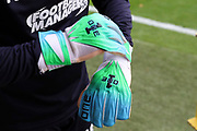AFC Wimbledon goalkeeping coach Ashley Bayes with new gloves during the EFL Sky Bet League 1 match between AFC Wimbledon and Luton Town at the Cherry Red Records Stadium, Kingston, England on 27 October 2018.