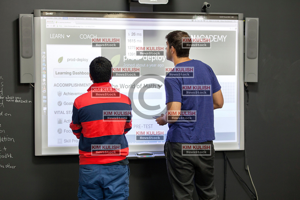 Salman Khan founded the Khan Academy.  A not-for-profit with the goal of changing education for the better by providing a free world-class education for anyone anywhere.  Engineers tests website on a smart board.