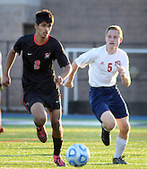 Newark Academy's Kiran Damodaran #2 and Moorestown Friend's Eric Price #5 chase a loose ball in the first half of the non-public B boys soccer state championship game Sunday November 15, 2015 at Kean University in Union, New Jersey. (Photo by William Thomas Cain)
