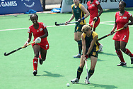 Jennifer Wilson shoots during the women's hockey match of the The Commonwealth Games between South Africa and Trinidad and Tobago held at the Stadium in New Delhi, India on the  October 2010..Photo by:  Ron Gaunt/SPORTZPICS/PHOTOSPORT