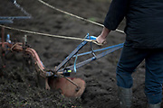 Irish ploughman Tom Nixon clears mud from his plough while leading Shire horses Nobby and Heath as they plough an on-going heritage wheat-growing area in Ruskin Park, a public green space in the borough of Southwark, on 9th February 2018, in London, England. The Friends of Ruskin Park are again growing heritage wheat and crops together with the Friends of Brixton Windmill and Brockwell Bake Association. Shire horses are descended from the medieval warhorse but are a breed under threat. Operation Centaur, which maintains the last working herd of Shires in London is dedicated to the protection and survival of the breed. It is an organization set up to promote the relevance of the horse as a contemporary working animal in partnership with humans. This takes the form of heritage skills in conservation and agriculture, transportation, discovery, learning and therapy.