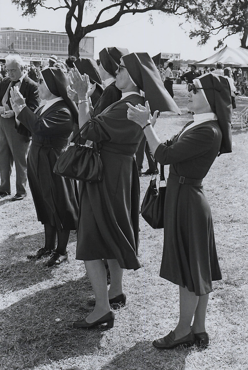 Nuns applaud during the third Louisiana jazz and Heritage festival at the New Orleans Fairgrounds in 1972