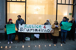 London, UK. 24 January, 2020. Activists attend a candlelit vigil outside the Brazilian embassy hosted by the London Mining Network to mark the first anniversary of the Brumadinho mining disaster when a wave of toxic sludge from a dam containing waste from an iron ore mine resulted in 272 deaths and 14 people missing. Brazil's largest mining company, Vale, which has links to UK multinational mining company BHP, had ignored warnings about the dam.