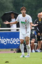 26.07.2015, Prien am Chiemsee, GER, Testspiel, FC Augsburg vs Norwich City, im Bild Jeong-Ho Hong (FC Augsburg #20) wundert sich, // during the International Friendly Football Match between FC Augsburg and Norwich City in Prien am Chiemsee, Germany on 2015/07/26. EXPA Pictures © 2015, PhotoCredit: EXPA/ Eibner-Pressefoto/ Krieger<br /> <br /> *****ATTENTION - OUT of GER*****