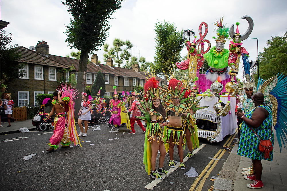 © Licensed to London News Pictures. 29/08/2016. London, UK. Carnival goers in costume wait to take part in  day two of the Notting Hill carnival, the second largest street festival in the world after the Rio Carnival in Brazil, attracting over 1 million people to the streets of West London.  Photo credit: Ben Cawthra/LNP