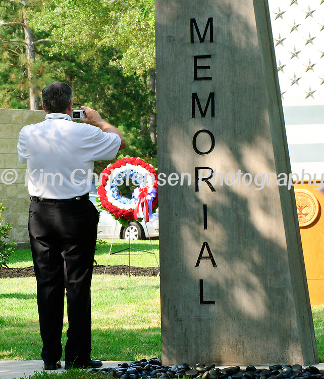 Patron takes a picture of the new Friendswood Veterans Memorial that was dedicated today.