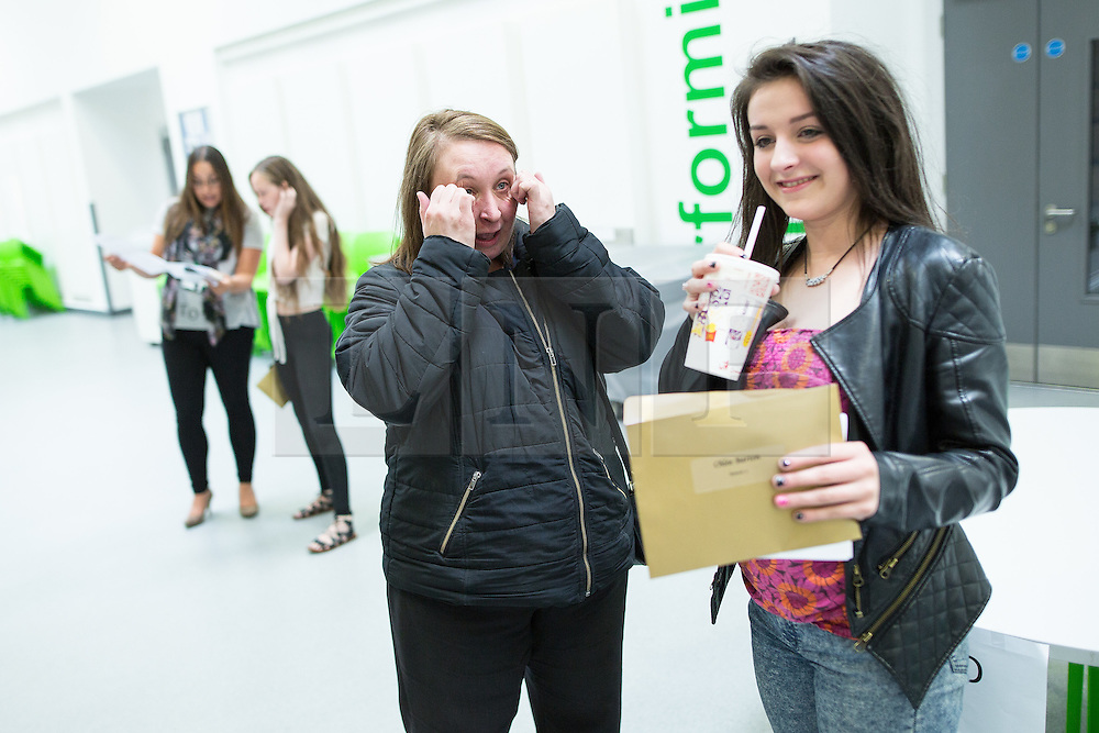 © Licensed to London News Pictures . 20/08/2015 . Salford , UK . Mother VICTORIA TORNAI cries with joy at daughter CHLOE BARTON's results . Students at St Patrick's RC High School in Eccles collect their GCSE results . Photo credit : Joel Goodman/LNP