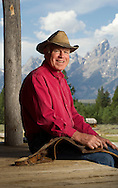 PRICE CHAMBERS / NEWS&amp;GUIDE<br /> John Turner served in the Wyoming State Legislature for 19 years, and is a past President of the State Senate. A third-generation rancher, Turner is also a former Assistant Secretary of State for Oceans, International Environment &amp; Scientific Affairs. At his family's dude ranch in Grand Teton National Park, Triangle X, he sits on the porch of their first guest cabin, a wooden building that served as a schoolhouse in the late 1940's, and where his father died in 1960.