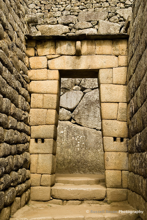 A view of a classic inca double-jam doorway at Machu Picchu in the Peruvian Andies
