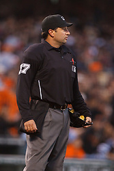 July 7, 2011; San Francisco, CA, USA;  MLB umpire Jim Reynolds (77) stands behind home plate during the fifth inning between the San Francisco Giants and the San Diego Padres at AT&T Park. San Francisco defeated San Diego 2-1.