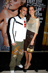 Model SOPHIE ANDERTON and MR MARK ALEXIOU at a party to celebrate Pamela Anderson's new role as spokesperson and newest face of the MAC Aids Fund's Viva Glam V Campaign held at Home House, Portman Square, London on 21st April 2005.<br />