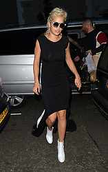 Singer Rita Ora dressed in monochrome leaves a studio and picks up a Caribbean takaway before heading home with boyfriend Richard Hilfiger. London, UK. 05/09/2014<br />