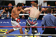 Manny Pacquiao trades with Ricky Hatton before the knockout in the second round of their Light Welterweight title fight at the MGM Grand, Las Vegas , Nevada, 2nd May 2009.