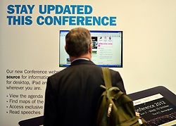 © Licensed to London News Pictures. 09/10/2012. Birmingham, UK A man uses an information board at The Conservative Party Conference at the ICC today 9th October 2012. Photo credit : Stephen Simpson/LNP