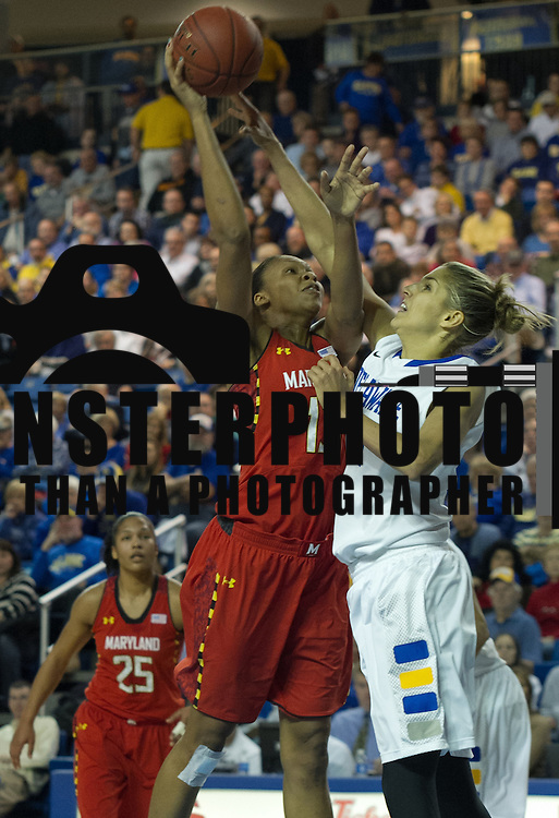 Delaware Forward Elena Delle Donne (11) attempts to block Maryland Center Alicia DeVaughn (13) shot in the first half of a regular season NCAA Women's basketball game at Delaware Thursday, Dec. 20, 2012 at the Bob Carpenter Center in Newark Delaware.