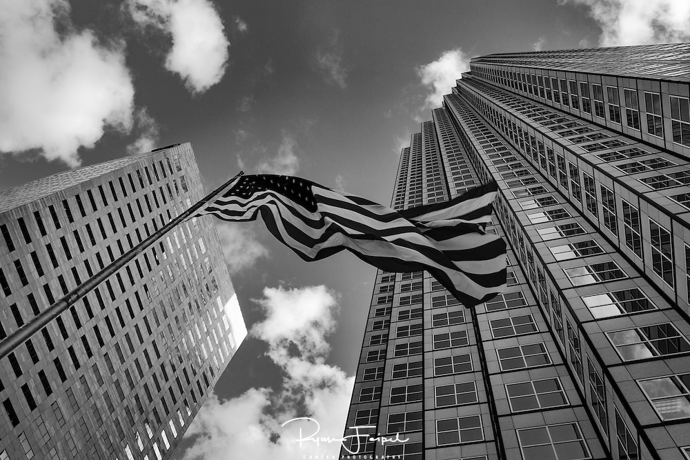 Downtown Miami Florida.  I wandered around the streets looking for a good shot.  Looking up I found the view I wanted.  The American flag standing tall amongst the buildings helped to put the American spirit into perspective.
