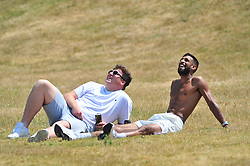 © Licensed to London News Pictures. 03/07/2018<br /> Greenwich, UK.<br /> Heatwave weather continues today with people enjoying the sun at Greenwich Park,Greenwich.<br /> (Verbal permission given to photograph)<br /> Photo credit: Grant Falvey/LNP