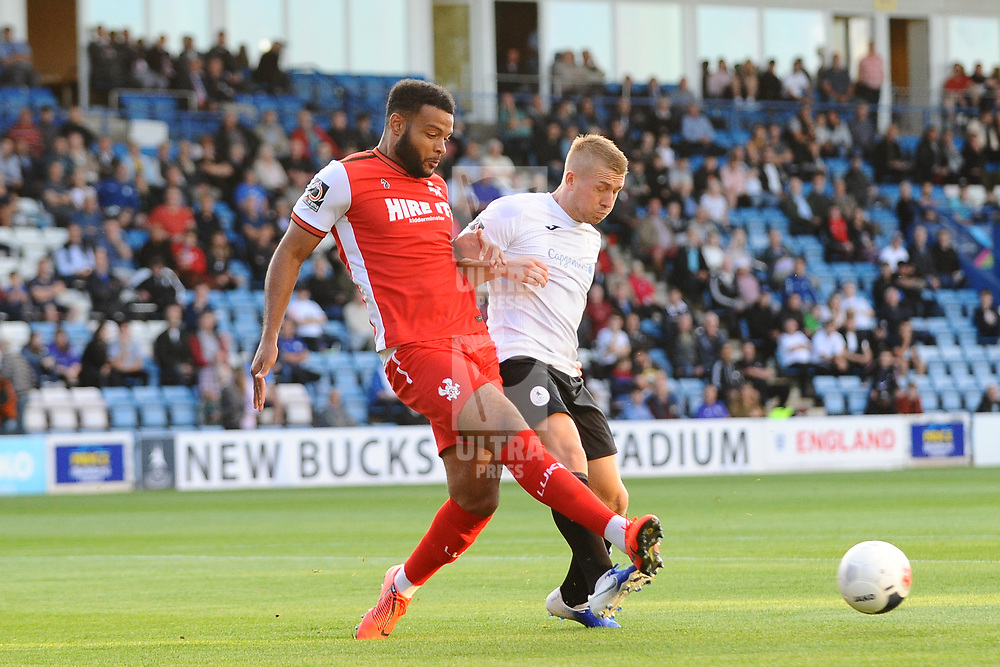 TELFORD COPYRIGHT MIKE SHERIDAN Darryl Knights battles with Ryan Johnson during the National League North fixture between AFC Telford United and Kidderminster Harriers on Tuesday, August 6, 2019.<br /> <br /> Picture credit: Mike Sheridan<br /> <br /> MS201920-006