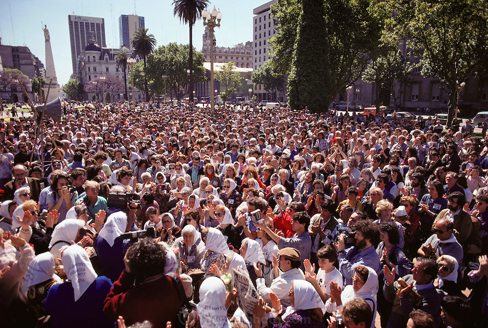 "(1992) The weekly march of Las Madres y las Abuelas de los Desparacidos (the mothers and grandmothers of the disappeared) in front of the Casa Rosada, the residence of the President of Argentina in Buenos Aires.  There was an estimated crowd of 700 people.  These groups demonstrated weekly for many years before the government admitted responsibility for thousands of political ""disappearances"" (murders). DNA fingerprinting has identified some of the victims, and a number of the families have been re-united."
