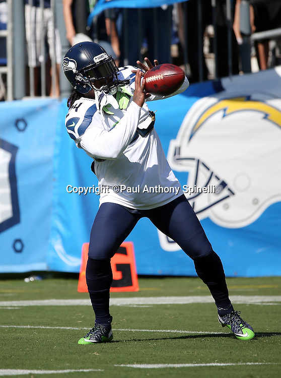 Seattle Seahawks running back Marshawn Lynch (24) catches a pass while warming up before the 2015 NFL preseason football game against the San Diego Chargers on Saturday, Aug. 29, 2015 in San Diego. The Seahawks won the game 16-15. (©Paul Anthony Spinelli)