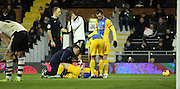 Preston striker Stevie May looks injured as Fulham players can't watch during the Sky Bet Championship match between Fulham and Preston North End at Craven Cottage, London, England on 28 November 2015. Photo by Pete Burns.