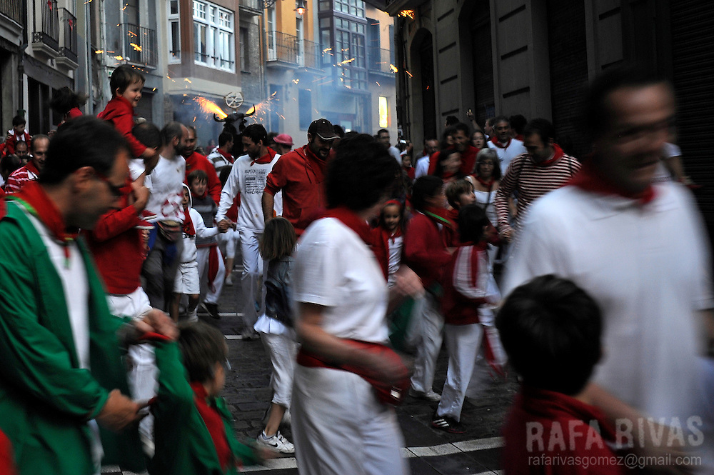 A bull of fire chases people during the San Fermin Festival, on July 8, 2014, in Pamplona, northern Spain. The festival is a symbol of Spanish culture that attracts thousands of tourists to watch the bull runs despite heavy condemnation from animal rights groups. PHOTO / RAFA RIVAS