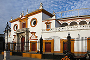 Low angle view of the Plaza de Toros de la Real Maestranza de Caballeria de Sevilla, Seville, Spain, pictured on December 30, 2006, in the afternoon. The Plaza de Toros de la Real Maestranza, 1762-1881, is the oldest bullring in Spain. Its Baroque facade, was built by several architects. The 16th century iron gates of the Puerta del Principe, by Pedro Roldan, were originally made for a convent. Picture by Manuel Cohen.