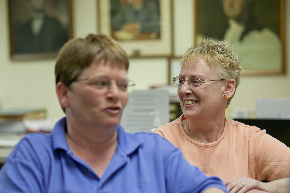 Nancy Ryherd (left) and Linda Schroeder, who have been together for seven years, fill out paperwork while applying for their civil union license in the county clerk's office at the Macon County Office Building just after 12 midnight Wednesday, June 1, 2011, in Decatur, Ill. The Decatur couple were the first in line when the Macon county clerk started accepting applications. (Stephen Haas)
