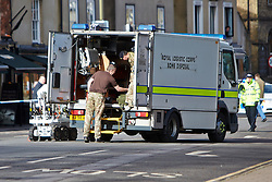 "© Licensed to London News Pictures.  13/02/2014. OXFORD, UK. Bomb disposal officers at the scene after a suspect package was received at the Army recruitment office in St Giles, Oxford. The package was one of seven received across the country in the last two days and has been described as ""crude but potentially viable with hallmarks of Northern Ireland-related terrorism. Photo credit: Cliff Hide/LNP"