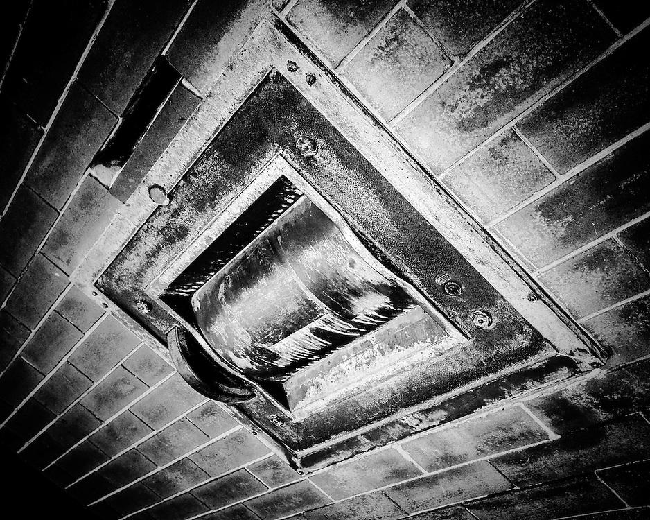 Steel bank deposit box, Ybor City (Tampa), Florida. Black & white. Photo by Richard M. Porter