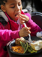 A girl enjoys her Thanksgiving meal on Wednesday November 25, 2015, in Los Angeles. Thousands of Skid Row residents and homeless people from downtown and beyond were served Thanksgiving dinners during the Los Angeles Mission's annual holiday feast. (Photo by Ringo Chiu/PHOTOFORMULA.com)<br /> <br /> Usage Notes: This content is intended for editorial use only. For other uses, additional clearances may be required.