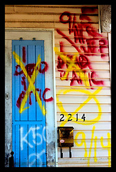 october 25th, 2005. Post Hurricane Katrina. New Orleans, Louisiana. The 8th ward lies in ruins following Katrina's devastating floods. Graffiti dated 9/11 marks '1 dead in attic' now crossed out following the later collection of the body.
