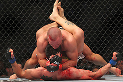 Montreal, Quebec, CAN - November 17, 2012: UFC Welterweight Champion Georges St. Pierre (top) and Interim UFC Welterweight Champion Carlos Condit (bottom) during their main event bout at UFC 154 at the Bell Centre in Montreal, Quebec, Canada. St. Pierre won via unanimous decision.