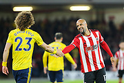 Sheffield United forward David McGoldrick (17) smiles and shakes hands with Arsenal defender David Luiz (23) during the Premier League match between Sheffield United and Arsenal at Bramall Lane, Sheffield, England on 21 October 2019.