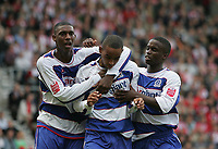 Photo: Lee Earle.<br /> Southampton v Queens Park Rangers. Coca Cola Championship. 30/09/2006. QPR's Ray Jones (L) and Stefan Bailey (R) congratulate Dexter Blackstock after his first goal.